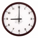 16420120-classic-analog-clock-pointing-at-9-o-clock-isolated-on-white-background