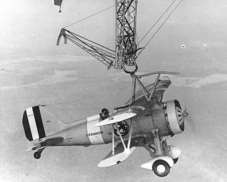 An F9C-2 captures the trapeze aboard Macon in 1933